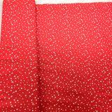 Červená s malými hviezdičkami bavlnená látka